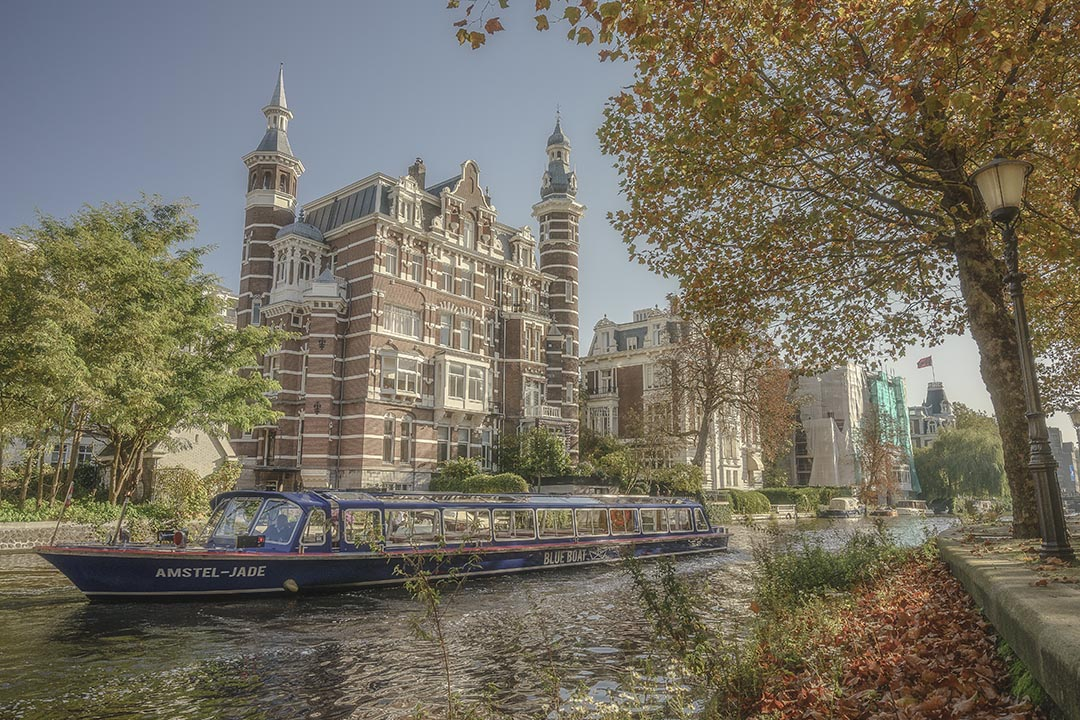 Amsterdam Canal with Tour Boat on Fall Day