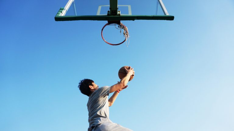 Dunking a basketball