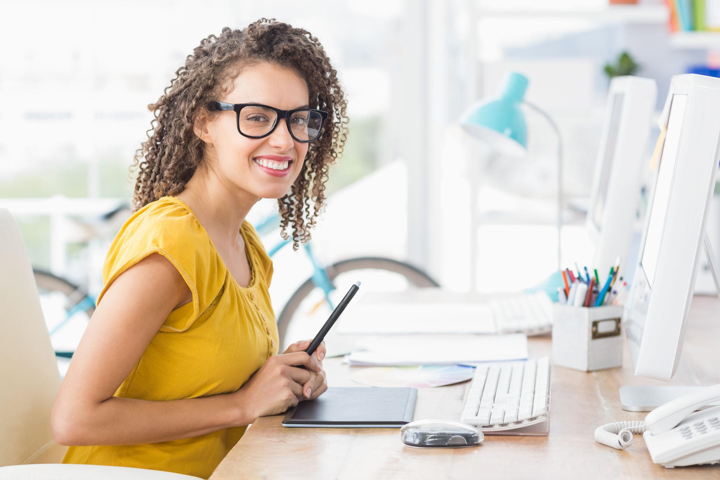 Female Creative Director at desk