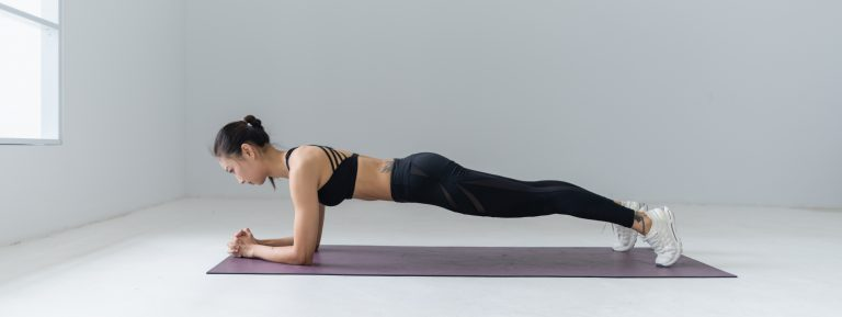 Woman planking in exercise studio